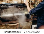 coffee machine with steam in... | Shutterstock . vector #777107620