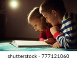 two happy siblings reading book ... | Shutterstock . vector #777121060