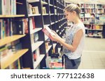 young woman choosing a book to... | Shutterstock . vector #777122638