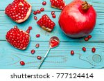 pomegranate and seeds close up... | Shutterstock . vector #777124414