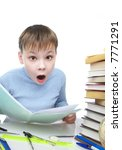 The boy behind a table with books - stock photo