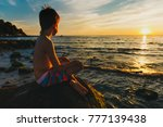 boy sits on a rock by the sea. ... | Shutterstock . vector #777139438