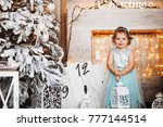 pretty little girl in blue... | Shutterstock . vector #777144514
