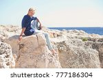young male sitting on textured... | Shutterstock . vector #777186304