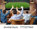 group of young men cheering on... | Shutterstock . vector #777227464