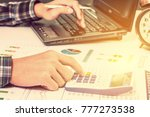 Small photo of Insight financial report analysis concept : Businessman or CFO sees, calculates and analyses a firm annual / summary reports with graphs and charts on a table in the office before public disclosure.