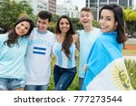 Laughing argentinian sports fan with other supporters from Argentina