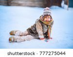 the girls playing with snow in... | Shutterstock . vector #777275044