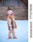 the girls playing with snow in... | Shutterstock . vector #777275050