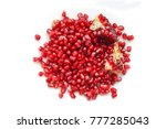 red ripe pomegranate grains on... | Shutterstock . vector #777285043