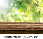 empty wooden table background | Shutterstock . vector #777293104