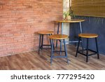 wood chair and table on brick... | Shutterstock . vector #777295420