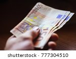 euro banknotes in man hand... | Shutterstock . vector #777304510