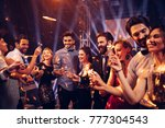 group of friends at a party... | Shutterstock . vector #777304543