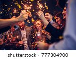 group of friends celebrating at ... | Shutterstock . vector #777304900