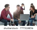 two men working on laptop in... | Shutterstock . vector #777318856