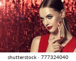 beautiful model girl with red... | Shutterstock . vector #777324040