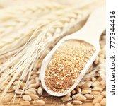 wheat bran in wooden spoon on... | Shutterstock . vector #777344416