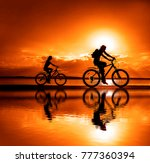 sporty friends on bicycle on... | Shutterstock . vector #777360394