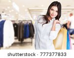 happy girl with shopping bag   Shutterstock . vector #777377833