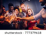 group of friends celebrating... | Shutterstock . vector #777379618
