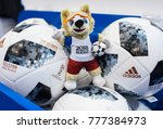 Small photo of December 14, 2017 Moscow, Russia, Soft toys in the form of the official mascot of the 2018 FIFA World Cup Zabivaka wolf and official ball Adidas Telstar 18 in the official store.