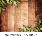 green leaves on the old wooden background - stock photo
