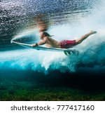young surfer dives under the... | Shutterstock . vector #777417160