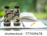 bird watcher and bird watching...   Shutterstock . vector #777439678