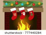 stockings hanging on the...   Shutterstock .eps vector #777440284