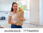 young asian woman holding... | Shutterstock . vector #777460003