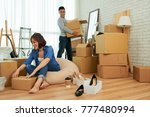 happy young couple unpacking in ... | Shutterstock . vector #777480994
