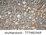 a textured natural stone wall... | Shutterstock . vector #777481969