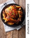 baked whole chicken with... | Shutterstock . vector #777523453