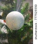 Small photo of Christmas ball on tree with burr back