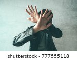 male protecting face from... | Shutterstock . vector #777555118