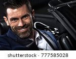 handsome man in the car | Shutterstock . vector #777585028