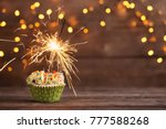 cupcake with sparkler on old... | Shutterstock . vector #777588268