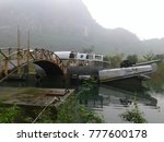 broken boat and the bridge