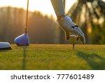 hand asian woman putting golf... | Shutterstock . vector #777601489