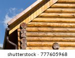 house with a log house in the...   Shutterstock . vector #777605968