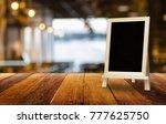 chalkboard standing on wood... | Shutterstock . vector #777625750