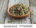 pumpkin seeds in wooden  bowl | Shutterstock . vector #777633484