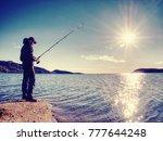 fisherman check pushing bait on ... | Shutterstock . vector #777644248