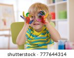 cute cheerful kid with hands... | Shutterstock . vector #777644314