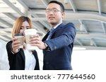 businessman and businesswoman... | Shutterstock . vector #777644560