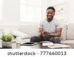 happy young african american... | Shutterstock . vector #777660013