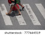 legs of tourist walking across... | Shutterstock . vector #777664519