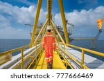 an offshore oil rig worker walk ... | Shutterstock . vector #777666469