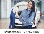woman at a car garage getting... | Shutterstock . vector #777674509